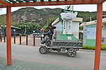The only motor vehicles on Lamma Island are small tractors or ATVs used by caretakers and construction workers who fly along the stone paths at great rates of speed.