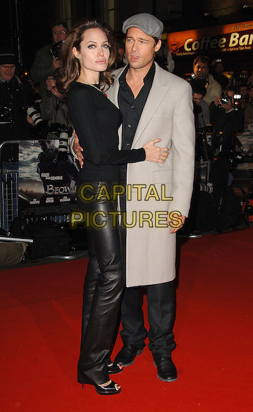 "ANGELINA JOLIE & BRAD PITT.The UK film premiere of ""Beowulf"", Vue Leicester Square, London, England..November 11th, 2007.full length black grey gray flat cap hat stubble facial hair couple beige jacket top leather trousers coat .CAP/ BEL.©Tom Belcher/Capital Pictures."