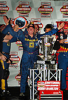 Nascar Craftsman Truck driver Bobby Hamilton celebrates after winning the 2004 championship. Mandatory Credit: Mark J. Rebilas