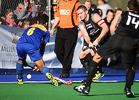 NZ captain Phil Burrows sets up the first goal during the international hockey match between the New Zealand Black Sticks and Malaysia at Fitzherbert Park, Palmerston North, New Zealand on Sunday, 9 August 2009. Photo: Dave Lintott / lintottphoto.co.nz