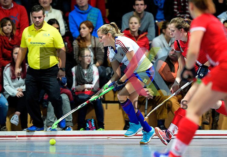 GER - Mannheim, Germany, December 05: During the 1. Bundesliga Sued Damen indoor hockey match between Mannheimer HC (white) and TSV Mannheim (red) on December 5, 2015 at Irma-Roechling-Halle in Mannheim, Germany. Final score 7-1 (HT 5-0).  Laura Bassemir #25 of Mannheimer HC<br /> <br /> Foto &copy; PIX-Sportfotos *** Foto ist honorarpflichtig! *** Auf Anfrage in hoeherer Qualitaet/Aufloesung. Belegexemplar erbeten. Veroeffentlichung ausschliesslich fuer journalistisch-publizistische Zwecke. For editorial use only.