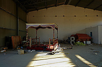 Tripoli, Libya, August 25, 2011.An official tribune and red carpets lay in a hangar from Khaddafi's Bab Aziziya compound, now entirely in the hands of the rebels.