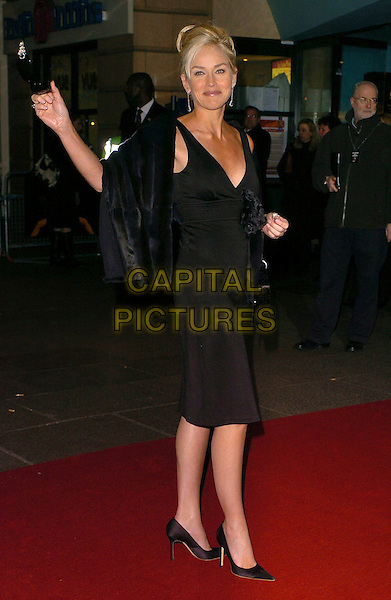 "SHARON STONE.""Basic Instinct 2: Risk Addiction"" world film premiere at.vue cinema, Leicester Sqaure, London England, .March 15th, 2006.Ref: CAN.full length black dress corsage purse blue fur.www.capitalpictures.com.sales@capitalpictures.com.©Steve Finn/Capital Pictures"