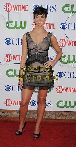 Morena Baccarin.arriving at the TCA Party for CBS, The CW and Showtime held at The Pagoda in Beverly Hills, California, USA,.August 3rd, 2011. .full length  tiered black sheer pleated  ruffle sleeveless  open toe shoes dress hand on hip.CAP/ROT/TM.©TM/Roth Stock/Capital Pictures