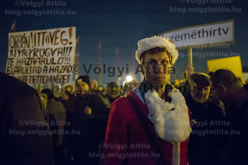 Man in Santa Claus dress attends a protest against government corruption in Budapest, Hungary on December 04, 2014. ATTILA VOLGYI