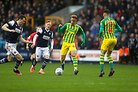 9th February 2020; The Den, London, England; English Championship Football, Millwall versus West Bromwich Albion; Callum Robinson of West Bromwich Albion passes the ball with Jake Cooper of Millwall marking