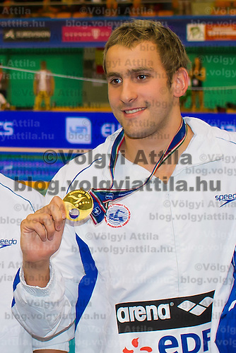 Jonatan Kopelev of Israel celebrates his victory in the Men's 50m Backstroke of the 31th European Swimming Championships in Debrecen, Hungary on May 23, 2012. ATTILA VOLGYI
