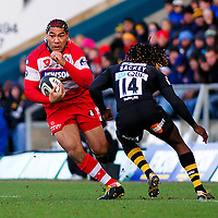 Lesley Vainikolo attempts to muscle his way past Paul Sackey. Guinness Premiership match between London Wasps and Gloucester on March 7, 2010 at Adams Park in High Wycombe, England. [Mandatory Credit: Patrick Khachfe/Onside Images]