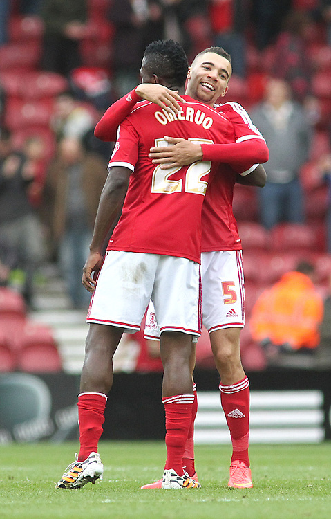 Middlesbrough's Kenneth Omeruo and Ryan Fredericks embrace at the final whistle <br /> <br /> Photographer Rich Linley/CameraSport<br /> <br /> Football - The Football League Sky Bet Championship - Middlesbrough v Fulham - Saturday 04th October 2014 - Riverside Stadium - Middlesbrough<br /> <br /> &copy; CameraSport - 43 Linden Ave. Countesthorpe. Leicester. England. LE8 5PG - Tel: +44 (0) 116 277 4147 - admin@camerasport.com - www.camerasport.com