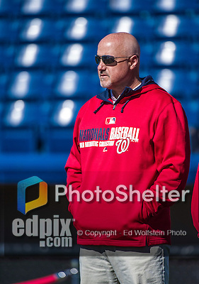 13 March 2014: Washington Nationals General Manager Mike Rizzo watches his team take batting practice prior to a Spring Training game against the New York Mets at Space Coast Stadium in Viera, Florida. The Mets defeated the Nationals 7-5 in Grapefruit League play. Mandatory Credit: Ed Wolfstein Photo *** RAW (NEF) Image File Available ***
