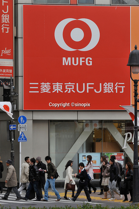 Mitsubishi UFJ Financial Group Inc., Japan's biggest bank. The bank cut its full-year profit forecast after a third-quarter loss on rising bad loans and soured stock holdings. Japan has been hit extremely hard by the economic crisis and hundreds of thousands have lost their jobs in the last two months....