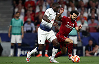 Liverpool's Mohamed Salah, right, is challenged by Tottenham Hotspur's Moussa Sissoko during the UEFA Champions League final football match between Tottenham Hotspur and Liverpool at Madrid's Wanda Metropolitano Stadium, Spain, June 1, 2019.<br /> UPDATE IMAGES PRESS/Isabella Bonotto