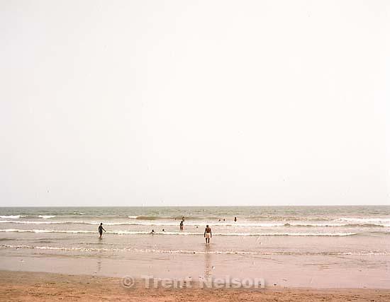 People in the ocean on Labadi Beach.<br />