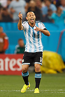 Javier Mascherano of Argentina shouts to this team mates