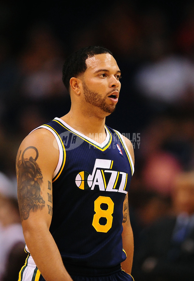 Oct. 12, 2010; Phoenix, AZ, USA; Utah Jazz guard (8) Deron Williams against the Phoenix Suns during a preseason game at the US Airways Center. Mandatory Credit: Mark J. Rebilas-