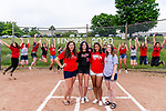 WOLCOTT, CT. 10 June 2020-061020BS18 - From left, Wolcott Girls Softball seniors Josie Cammarata, Eily Chambers, Jade Abdul-Lateef, and Abby Sullivan stand on home plate for a photo together as the rest of the Wolcott Girls Softball Team celebrates in the background as they honor the Wolcott Girls Softball team seniors at the Wakelee Elementary School field on Wednesday. Bill Shettle Republican-American