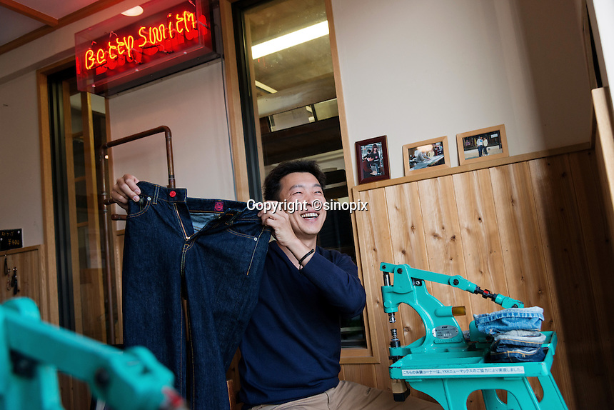 MAY 15, 2014 - KOJIMA, KURASHIKI, JAPAN: Visitors experience customizing jeans they purchased at Betty Smith CO.(Photograph / Ko Sasaki)