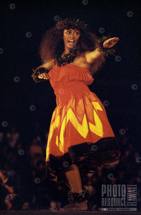 Woman (wahine) dancing Kahiko (modern form) hula at the Merrie Monarch festival on the Big Island
