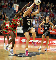 31.10.2013 Silver Fern Casey Williams and Malawi's Joyce Mvula in action during the Silver Ferns V Malawi during the New World Netball Series played at the Claudelands Arena in Hamilton. Mandatory Photo Credit ©Michael Bradley.
