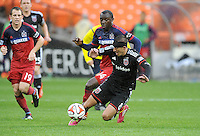 Washington, D.C.- March 29, 2014. Davy Arnaud (8) of D.C. United goes against Jhon Kennedy Hurtado of the Chicago Fire.  The Chicago Fire tied D.C. United 2-2 during a Major League Soccer Match for the 2014 season at RFK Stadium.
