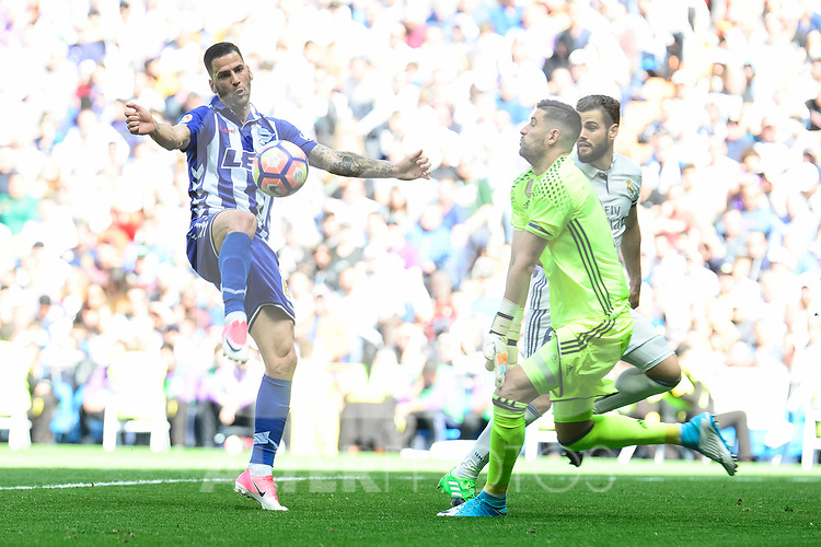 Real Madrid's Kiko Casilla and Deportivo Alaves's Edgar Mendez during La Liga match between Real Madrid and Deportivo Alaves at Stadium Santiago Bernabeu in Madrid, Spain. April 02, 2017. (ALTERPHOTOS/BorjaB.Hojas)