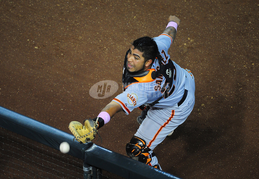 May 13, 2012; Phoenix, AZ, USA; San Francisco Giants catcher Hector Sanchez is unable to catch a foul ball in the sixth inning against the Arizona Diamondbacks at Chase Field. Mandatory Credit: Mark J. Rebilas-