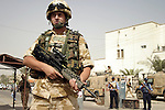 British Soldiers and Iraqi policemen keep watch during a liaison visit by Royal Engineers to the centre of Basrah City.