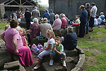 The annual Padley Martyrs Roman Catholic Pilgrimage. Padley, Padley Chapel, Grindleford, Derbyshire  UK 2008. Mother with four bored children at open air church service.