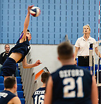 OXFORD,  CT-041519JS14- Oxford's Patrick Mucherino (13) spikes the ball over the net for a point during their match with Joel Barlow Monday at Oxford High School. <br /> Jim Shannon Republican American