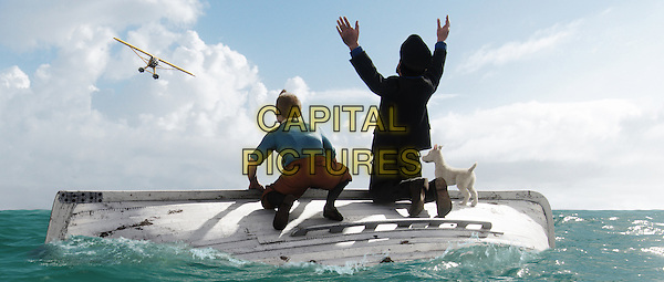 Tintin (played by Jamie Bell), Haddock (played by Andy Serkis) and Snowy await rescue..in The Adventures of Tintin: The Secret of the Unicorn .*Filmstill - Editorial Use Only*.CAP/FB.Supplied by Capital Pictures.