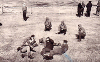 BNPS.co.uk (01202 558833)<br /> Pic: DNW/BNPS<br /> <br /> The captured Argentine's on the race course at Stanley in the Flaklands after the incident was over. <br /> <br /> The incredible tale of Argentina's little known first invasion of the Falklands islands revealed as Royal Marine heroes medals are sold.<br /> <br /> The medal group of a Royal Marine who was taken hostage by Argentinian terrorists when they tried to claim the Falklands 16 years before the war are being sold.<br /> <br /> Major Alan Wiles was serving as a PT instructor for the Dad's Army-like Falkland Islands Defence Force when a hijacked Argentine airliner landed on the racecourse at Stanley. <br /> <br /> Thinking the Douglas DC-4 plane was in distress the British army officer, who was trout fishing at the time, rushed to the scene only to be met by 18 armed hijackers.<br /> <br /> The El Condor group, that had forced the pilot at gunpoint to divert 400 miles to the Falklands, raised the Argentine flag and demanded Britain recognised the islands as their country's.<br /> <br /> They surrendered less than 24 hours later.<br /> <br /> Now Maj Wiles medals are coming up for auction in London.