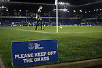 A sign warning people to keep off the pitch as players warm up at Goodison Park, Liverpool before the Premier League match between Everton and West Bromwich Albion. The match ended in a 0-0 draw, despite the home team missing a first-half penalty by Kevin Mirallas. The game was watched by 34,739 spectators and left both teams languishing near the relegation zone.