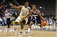 February 03, 2011:    Belmont Bruins guard Kerron Johnson (3) brings the ball up court while being guarded by Jacksonville Dolphins guard Keith McDougald (20) during Atlantic Sun Conference action between the Jacksonville Dolphins and the Belmont Bruins at Veterans Memorial Arena in Jacksonville, Florida.  Belmont defeated Jacksonville 76-70.