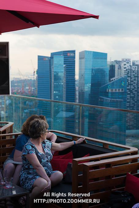 Visitors of Marina Bay Sands Bar enjoying the stunning panorama of Singapore