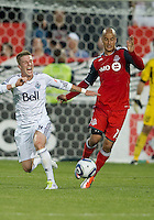 Vancouver Whitecaps FC defender Wes Knight #8 and Toronto FC defender Mikael Yourassowsky #19 in action during an MLS game between the Vancouver Whitecaps FC and the Toronto FC at BMO Field in Toronto on June 29, 2011..Toronto FC won 1-0..