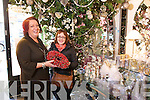 Marie Kennelly, Elizabelle shows Evelyn O'Connor  the impressive selection of Christmas ornaments.