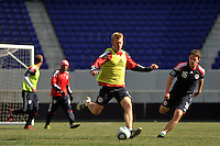 Tim Ream (5) of the New York Red Bulls plays the ball as John Rooney (16) watches during practice on Media Day at Red Bull Arena in Harrison, NJ, on March 15, 2011.