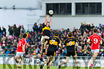Johnny Buckley, Dr Crokes in action against Liam Kearney, East Kerry  during the Kerry County Senior Club Football Championship Final match between East Kerry and Dr. Crokes at Austin Stack Park in Tralee, Kerry.
