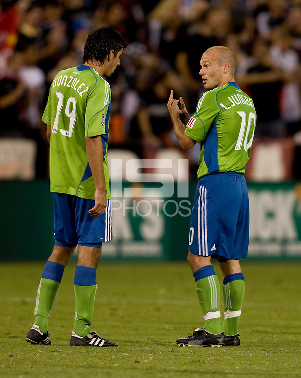 Freddie Ljungberg, Leonardo Gonzalez. The Seattle Sounders defeated DC United, 2-1, to win the 2009 Lamr Hunt U.S. Open Cup at RFK Stadium in Washington, DC.