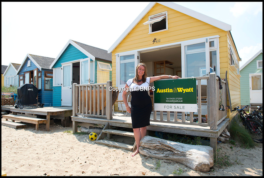 BNPS.co.uk (01202 558833)<br /> Pic: LauraDale/BNPS<br /> <br /> Sales Manager Victoria Berry from Austin &amp; Wyatt stands outside the property.<br /> <br /> A modest beach hut with no bathroom or mains electricity has gone on the market for a whopping 270,000 pounds - making it the most expensive in Britain.<br /> <br /> The asking price for the tiny wooden shack on Mudeford Spit near Christchurch, Dorset, is the same cost as a plush three-bedroom house in some parts of the country and is as much as a top-of-the-range Ferrari car.<br /> <br /> The 18ft by 12ft hut can sleep up to 12 people - four people on a mezzanine deck, four on two sofa beds and another two on a pull-out bed.<br /> <br /> The huge asking price is because it is just a stones throw away from the water boasting stunning sea views out towards the Isle of Wight and the Needles.<br /> <br /> The current owners are selling the beach hut so that they can move to another one on the same sandy strip with a different view.