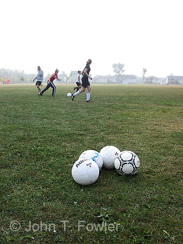 Coaching teen aged girl's soccer practice<br />