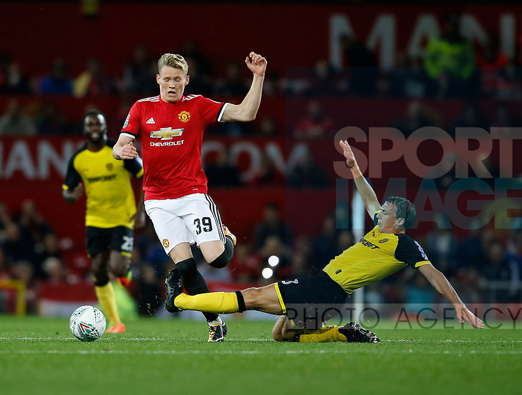 Scott McTominay of Manchester United tackled by Stephen Warnock of Burton Albion during the Carabao Cup Third Round match at the Old Trafford Stadium, Manchester. Picture date 20th September 2017. Picture credit should read: Simon Bellis/Sportimage
