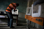 Poll workers assemble ballot boxes before hte opening of a voting station for presidential and legislative elections on November 28, 2010 in Port-au-Prince, Haiti.