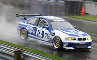 The #16 BMW M3 of Joey Hand, Justin Marks and Tom Milner races through the rain at the 6 Heueres du Circuit Mont-Tremblant in Mont-Tremblant, Qubec, Canada, on Saturday, May 21, 2005. (Photo by Brian Cleary/www.bcpix.com)