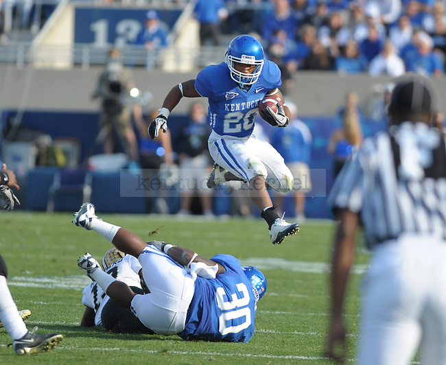 UK's Derrick Locke hurdles two players during the second half of the University of Kentucky's game against Vanderbilt  at Commonwealth Stadium in Lexington, Ky., on 11/13/10. UK won the game 38-20. Photo by Mike Weaver | Staff