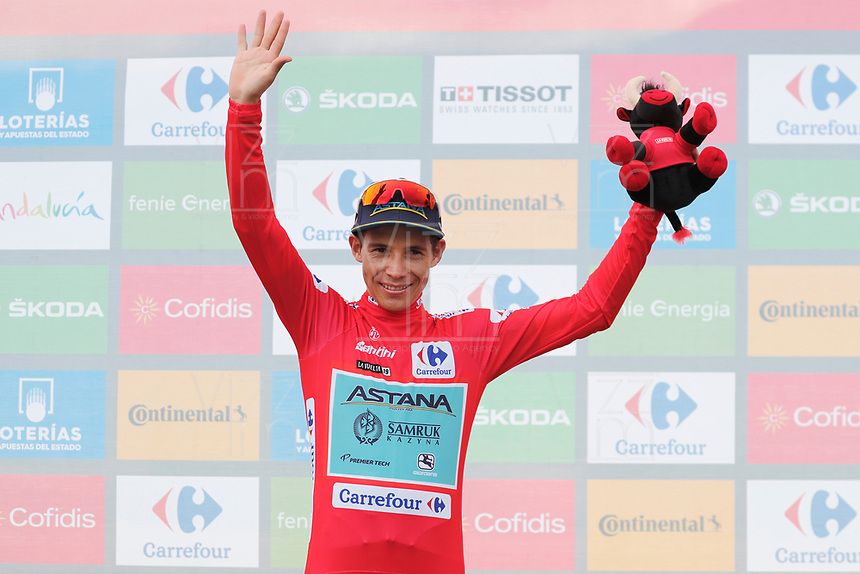 ESPAÑA, 30-08-2019: Miguel Angel lopez (COL - ASTANA) celebra con maillot rojo líder después de la etapa 7, hoy, 30 de agosto de 2019, que se corrió entre Onda y Mas de la Costa con una distancia de 183,2 km como parte de La Vuelta a España 2019 que se disputa entre el 24/08 y el 15/09/2019 en territorio Español. / Miguel Angel lopez (COL - ASTANA) celebrates with the red leader jersey after the stage 7 today, August 30, 2019, from Onda to Mas de la Costa with a distance of 183,2 km as part of Tour of Spain 2019 which takes place between 08/24 and 09/15/2019 in Spain.  Photo: VizzorImage / Luis Angel Gomez / ASO<br /> VizzorImage PROVIDES THE ACCESS TO THIS PHOTOGRAPH ONLY AS A PRESS AND EDITORIAL SERVICE AND NOT IS THE OWNER OF COPYRIGHT; ANOTHER USE HAVE ADDITIONAL PERMITS AND IS  REPONSABILITY OF THE END USER