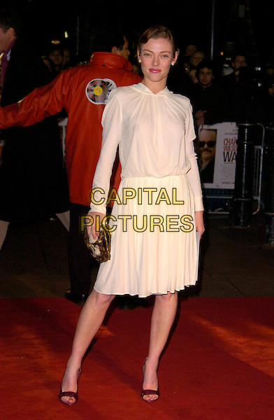 CAMILLA RUTHERFORD.Charlie Wilson's War - UK film premiere, Empire Leicester Square, London, England..January 9th, 2008.full length white cream dress gold clutch bag purse see through thru nipple .CAP/CAN.©Can Nguyen/Capital Pictures