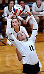 Althoff's Mary Wessel sets the ball in the second game. In background is teammate Grace Strieker. Althoff defeated Columbia in two games in volleyball action on Thursday August 23, 2018.<br /> Tim Vizer/Special to STLhighschoolsports.com