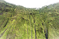 An aerial view of waterfalls flowing down a cliff on Mt. Wai'ale'ale, Kaua'i
