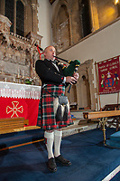 A bagpiper commemorates the 100 years since the end of the First World War on Remembrance Day at 6am in a church in Clydach near Swansea, south Wales, UK. Sunday 11 November 2018